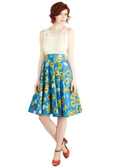 Sunflower Sunset Skirt. As you stand on the hotel balcony in this floral skirt, hand-in-hand with your friends and family, you begin to countdown in anticipation of the suns grand exit from the cloudless sky. #blue #modcloth