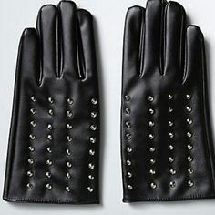 Torrid studded goth biker gloves faux leather The gloves are off...said no one ever when they sneaked a peek at these gloves. Smooth black faux leather is boosted by a velvet-like interior, but we're all about the punk rock touch thanks to silver tone studs.  One size fits most. I'd say they are probably about a large. Not much bigger. torrid Accessories Gloves & Mittens