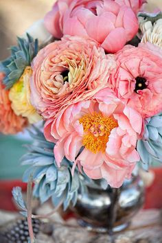 pastel blooms & succulents arranged in a silver urn