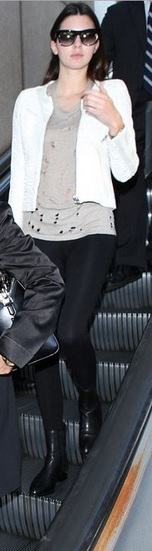 Who made  Kendall Jenner's tan ripped shirt, white jacket, and black ankle leather boots