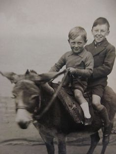 UNUSED TWO YOUNG BOYS ENJOYING A DONKEY RIDE SEASIDE RPPC POSTCARD
