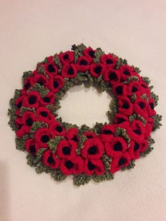 I made the wreath using the pattern Hampstead Wreath by Wendy Baker and Belinda Boadene Instead of using a Styrofoam ring or pipe lagging as suggested in the pattern I used a florist wreath wire r. Crochet Poppy Free Pattern, Knitted Flower Pattern, Crochet Flower Tutorial, Poppy Pattern, Knitted Flowers Free, Knitted Poppies, Crochet Flowers, Kawaii Crochet, Crochet Disney