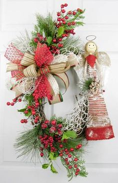 Ready for your Christmas decor, this sweet baby snow owl in a vintage burlap door hanger has all the right elements to usher in the season. Holly leaves, red berries, pine branches and evergreens fill