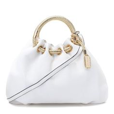 """Michael Kors Skorpios Textured Leather Ring Tote White Products Description * Ecru textured leather. * Golden hardware. * Gold braided leather top handles; 6"""" drop. * Shoulder strap. * Cinched snap top. * Hanging logo tag. * Inside, fabric lining and pockets. * 13""""H x 16 1/2""""W x 5""""D."""