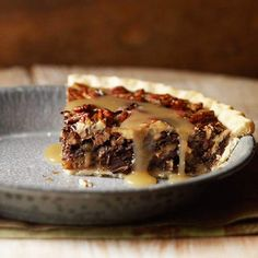 Chocolate Chunk and Caramel Pecan Pie? Yes, please! Get the recipe here: www.bhg.com/recipe/pies/chocolate-chunk-and-caramel-pecan-pie/?socsrc=bhgpin071212chocolatecaramelpecanpie