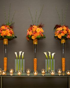 Fall Wedding Idea: Add White Flowers  White flowers will make the rich fall hues stand out. Plus, graphic calla lilies in contemporary containers instantly modernize the autumn arrangements.    Read more: 5 New Fall Wedding Ideas - Real Weddings - Fall Weddings http://wedding.theknot.com/real-weddings/fall-weddings/articles/5-new-fall-wedding-style-ideas.aspx#ixzz1rQgawUH7