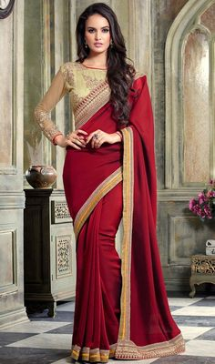 Genuine elegance can come out of your dressing design with this maroon color silk and satin sari. This enticing attire is displaying some extraordinary embroidery done with lace, resham and sequins work. Upon request we can make round front/back neck and short 6 inches sleeves regular saree blouse also. #reshambordersaree #marooncolorplainsari #latestnewdesignsari
