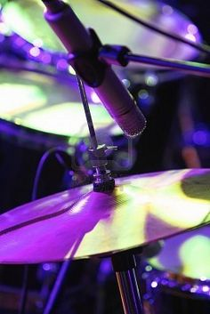 Although pinned with the description of purple drum kit, this obviously is not. It's a GREAT PHOTO COMPOSITION using stage lighting to add interest to the high hat and toms of this drumkit - with a special instrument microphone in the foreground to add interest, and reflective lighting from above. - DdO:) - http://www.pinterest.com/DianaDeeOsborne/great-photo-compositions/ - An example of how a CLOSE UP of any subject is like ART if cropped to leave out background clutter.