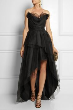 ALBERTA FERRETTI Tulle gown $4,125 EDITORS' NOTES & DETAILS The daughter of a tailor, Alberta Ferretti displays her couture-like creativity to full effect in this dramatically layered black tulle gown. Perfect for galas or special events, this sweeping design is flatteringly ruched at the bodice and underpinned by a sculpting boned corset. A satin lining ensures the two-level skirt moves elegantly as you walk.