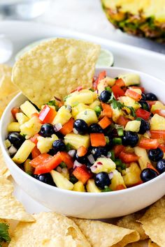 Refreshing Blueberry Pineapple Salsa is addictingly delicious with chips, on chicken, fish, tacos or just a spoon! This salsa makes everything better!