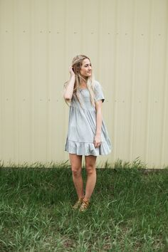 Lightweight, gray dress with a ruffled hem. Perfect to throw on for those  warm summer days!  Model is 5'9'' wearing size Small