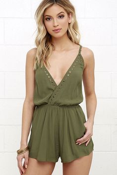 Take a closer look at the Second Look Olive Green Romper and you'll realize you can't live without it! Adjustable spaghetti straps support this breezy woven romper with a surplice front (with modesty snap) and gold grommet accents. Attached shorts flutter below an elasticized waist. Diagonal front pockets.