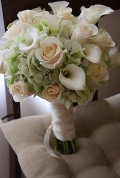 White calla, green hydrangea and roses.