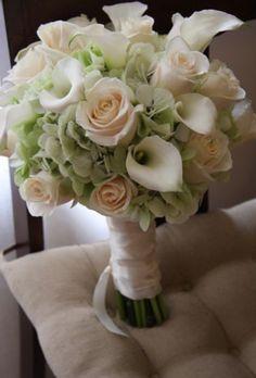 White calla, green hydrangea and roses.