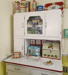 Love the bright refashioning of this vintage hutch, sometimes called a hoosier cabinet.