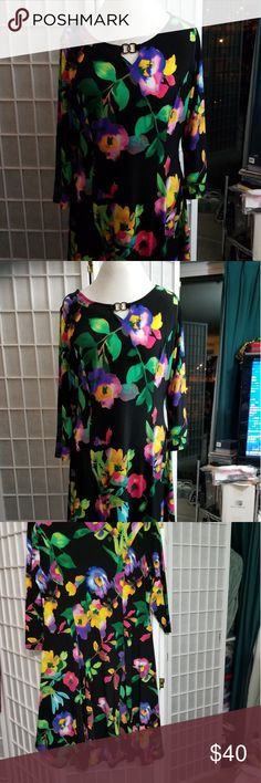 Black floral knit flared dress, sz M Black stretchy knit floral dress with princess seams and flared skirt in size M by Susan Graver. The dress is roomy and fits size 12-14. New, never worn. Susan Graver Dresses Midi