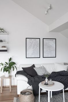 Monochrome and cozy nordic living room. Encyclopaedia Urbana posters. Styling and photography by Anu Tammiste for Decordots