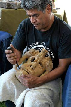 Artist Felipe De Jesus Horta Terra carving one of his wooden masks. Heard Museum Spanish Market, 2014. Photo by Jewel Clark.