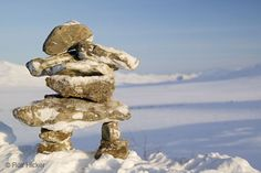 "An inukshuk is a stone sculpture in the form of an abstract person created by the Inuit people that inhabit North America and the Arctic Circle. These sculptures are not made to be decorative, but are used to communicate messages. I told the students to think of them as ""traffic signs"" in the wilderness. The arms could point in the direction of a safe passage. They may also be made to honor an ancestor. shine brite zamorano: an inukshuk... and ted."