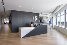 Office Tour: Stantec Office – Arlington - Lilly is Love Office Counter Design, Office Reception Design, Modern Reception Desk, Office Table Design, Corporate Office Design, Dental Office Design, Modern Office Design, Office Furniture Design, Office Designs