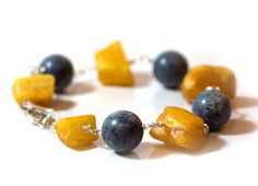 Handmade bracelet of blue coral and raw amber on sterling silver
