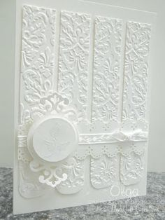 white card made using strips embossed with Kassie's Brocade folder, strips punched with Martha Stewarts border punch Eyelet Lace #paper_crafting #cards #crafts