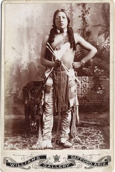 """JICARILLA APACHE MAN c. 1885 Silver gelatin cabinet card attributed to Dana Chase, but with the imprint of Williams Gallery, Safford, Ariz. Pencil inscription, verso: """"Apache Runner.""""Heritage Auctions. 2007 Dallas, TX - American Indian Art Signature Auction"""
