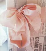 <3 Lush satin pink bow tied up on a newspaper wrapped package. Makes newspaper wrapping look adorable!