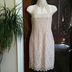 """NWT Super Cute Nude Halter Lace Dress Size M New With Tag Super Cute Halter Lace Dress from Charlotte Russe. Size M  NUDE color.  36"""" Length,  26-28"""" Waist,  30"""" Bust. 80% Cotton / 20% Nylon. Lining 100% Polyester Charlotte Russe  Dresses Midi"""