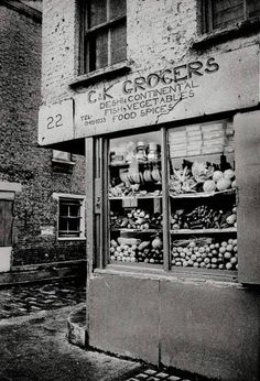 """C K Grocers, Spitalfields, East End of London. """"From the floor to the roof, the shop was stocked full of everything you could imagine."""" 1982"""