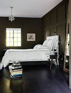 i would just change the ceiling to another color other than white like oprah says. maybe coral to add a touch of femininty to this masculine bedroom