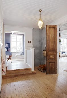 "There are some nice elements to this room. The rustic door, beautiful wooden floors and the ""Have a Nice Day"" is a quirky touch."