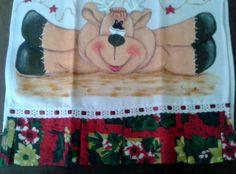 Pano de Prato confeccionado em algodão, pintado a mão, com detalhes em glitter, com barrado de motivos natalinos e passa fita. <br>Para decorar sua casa ou presentear com bom gosto.