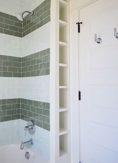 """Two different types of colored glass subway tiles with 12″-ish stripes up the wall from The Tile Shop in Snow Glass (3"""" x 6"""" tiles - $26.99/Sq Ft - Coverage: 8.40 Sq Ft/Box)  and Glass Winter (3"""" x 6"""" tiles - $23.99/Sq Ft - Coverage: 8.40 Sq Ft/Box)"""