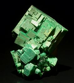 Torbernite  Locality: Margabal, Aveyron, France Size: Specimen is 0.7 inches tall.