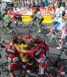 The BMC team celebrates Cadel Evans' overall win in 2011