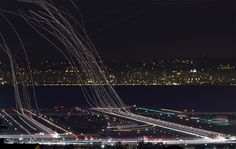 Airplane trails. The photographer took this fascinating long exposure photo in the skies above San Francisco International Airport