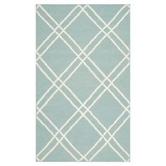 Flatweave wool and cotton rug with a diamond trellis motif. Handmade in India.   Product: RugConstruction Material: