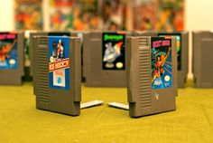 Nintendo Game Cartridge Bookends. Great idea, but we cringe at the desecration of Shadowgate.