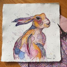 Mixed media hare on khadi paper with watercolour, raw edge applique and free motion stitching