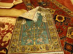 A Turkish prayer mat made from silk - Cost is 2000 USD.