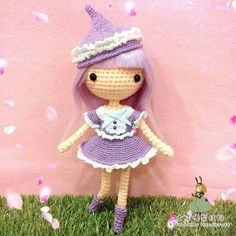 Crochet amigurumi doll in lilac and white outfit. (Inspiration).