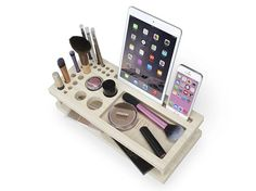 Beauty Station Line by iSkelter. A complete makeup organizer, display center, and universal docking station for your iPhone, iPad, and most phones and tablets. Each Beauty Station is chiseled and handcrafted from natural bamboo and hand-finished for a smooth touch.This product is designed and hand-built in Phoenix, Arizona by team iSkelter.With every product, we include a wrist band that says, I Give A Damn. Wear it as a reminder to care, don't cut corners, and to do your best. Thanks for…