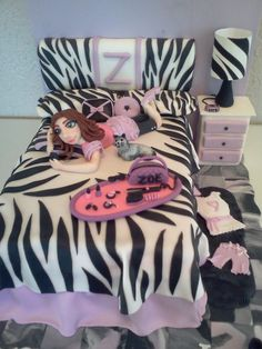 Little Diva Bedroom. The bed is cake. Used fondant to make the rest. Lamp shade was icing sheet. Covered styrofoam for headboard, pillows, and night stand. Floor tiles is a marble of colors used. Great Birthday Cake for pre-teen Diva Girl.