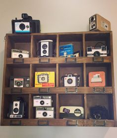 My vintage camera collection. I finally found a shelf to display it properly! Vintage Camera Decor, Vintage Decor, Antique Cameras, Vintage Cameras, Nikon, Small Room Interior, Vintage Room, Vintage Paper Dolls, Displaying Collections