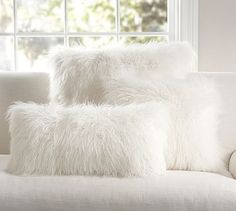 """Mongolian Faux Fur Pillow Cover - Ivory #potterybarn Love furry pillows for cuddling in winter! What are chances of finding one in teal :o) ($45/18""""square) Just want to add that I love this pillow against the teal blanket that's over my gray chair! It's like petting a kitty- except it doesn't purr :o("""