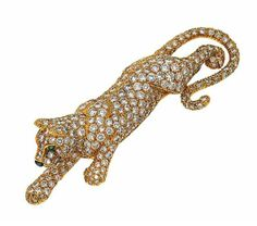 A diamond, onyx and emerald 'Panther' brooch, by Cartier   The pavé -set diamond panther with emerald-set eyes and onyx nose, 6.0 cm wide, French assay mark  Signed Cartier, no. 674216