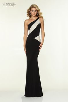 A stunning geometric jersey dress by Mori Lee, with lace panels, asymmetric shoulder strap and side zip.