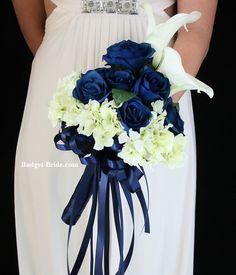 Navy Blue roses, white calla lilies, Marine Blue Ribbon that matches Davids Bridal, mint green hydrangea, artificial wedding bouquet