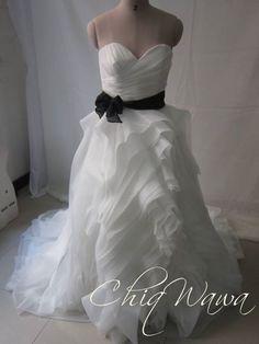 A beautiful dress from ChiqWawa www.chiqwawa.co.za - love the organza ruffled skirt!
